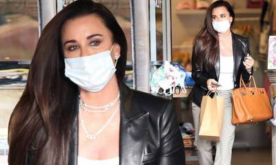 Kyle Richards has her hands full on a shopping excursion… as RHOBH is suspended due to COVID-19