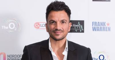Peter Andre dubbed 'sexy silver fox' as he unveils natural grey hair after Covid battle